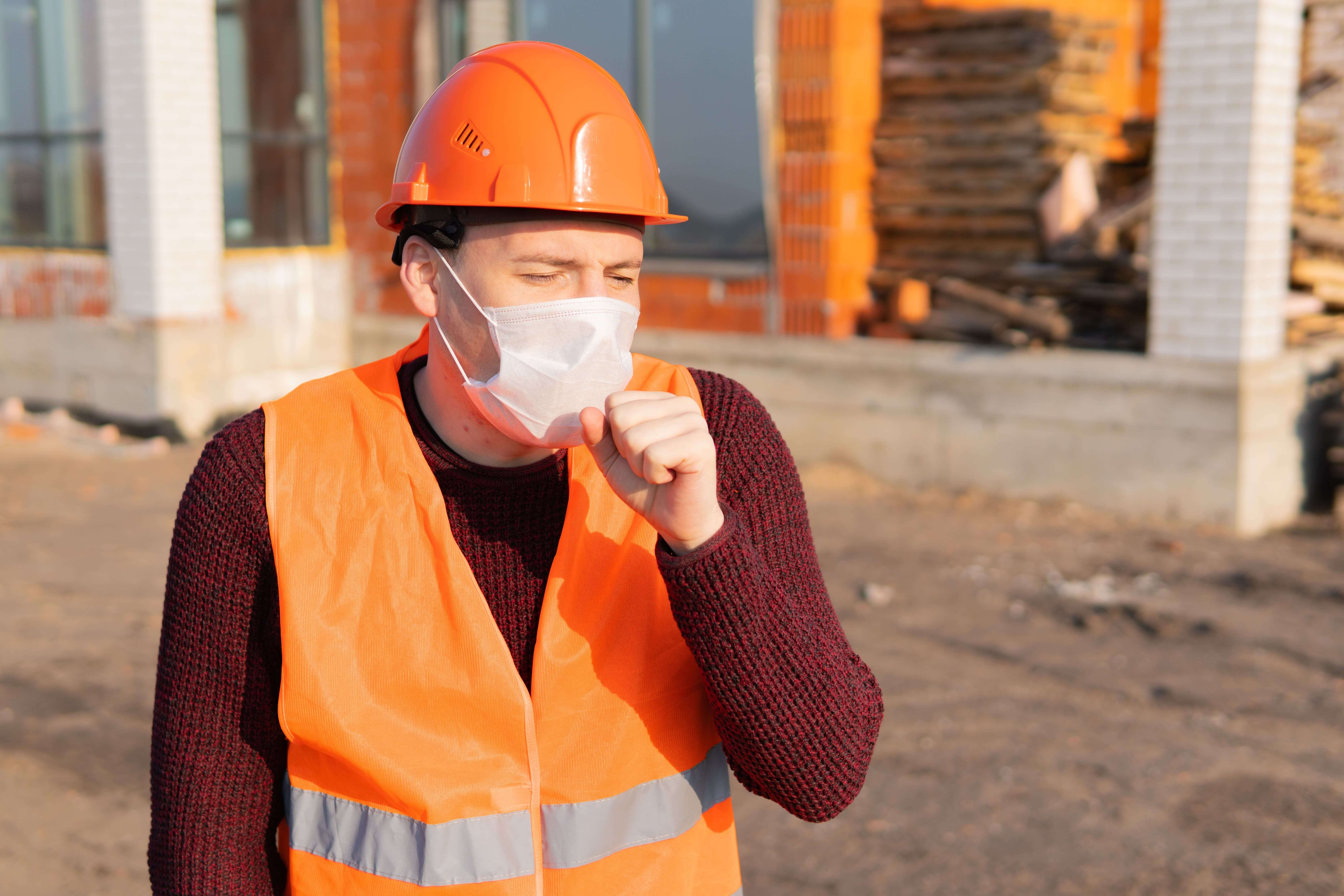 Coughing construction worker sign of mesothelioma.